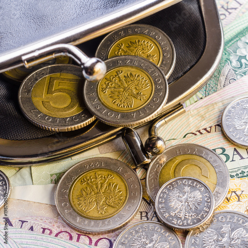 Fotografía  Polish Zloty (PLN) paper currency banknotes and coins in black wallet in vintage style
