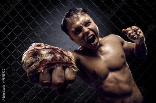Valokuva  muscular guy street-fighter