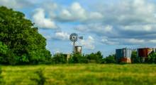 Old Windmill On A Farm In Texa...