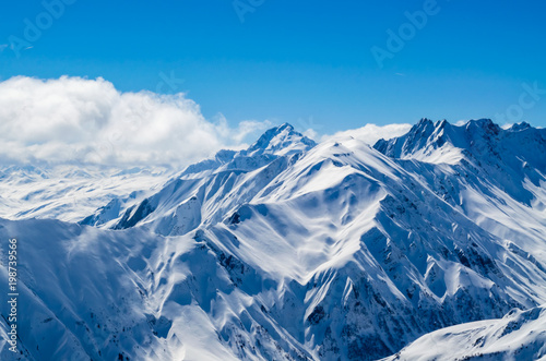 Drone view of the alps with sunny weather clear skies Wallpaper Mural