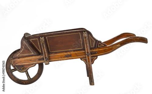 Slika na platnu Old wooden hand wheel barrow painted and hand made