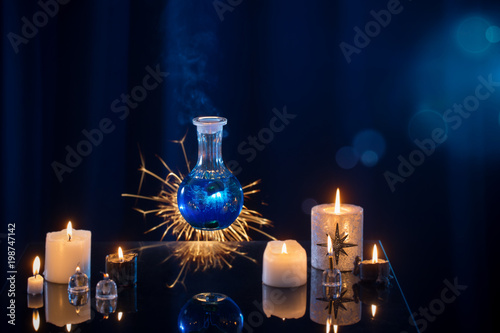 Fototapeta magic potions on a blue background obraz