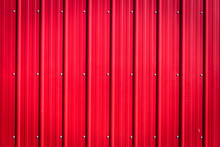 Red Corrugated Tin Blank Background With Rivets.