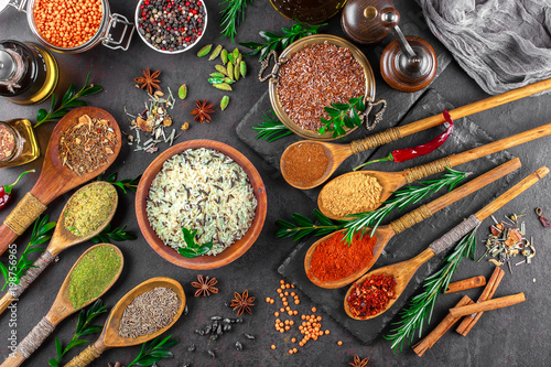 Fototapety, obrazy: Spices for cooking with kitchen accessories on an old background