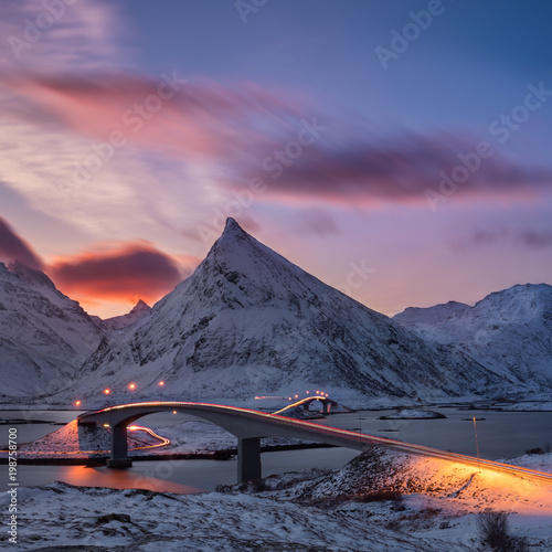 In de dag Ijsbeer early morning at the famous fredvang bridges, long exposed sky, light trails and an arctic winter landscape
