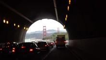 California Freeway Traffic. Congested Traffic Through Robin Williams Tunnel To Golden Gate Bridge And San Francisco.