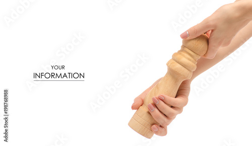 Fotomural Pepper mill wooden in hand pattern