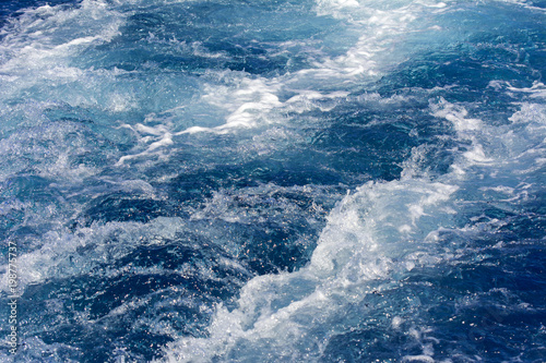 Autocollant pour porte Turbulence made by the foam of sea water from a high-speed yacht on the surface of the sea. Image for background, wallpaper or desktop, abstract texture