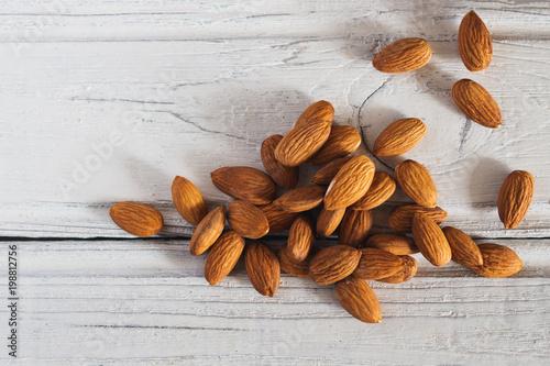 Cuadros en Lienzo Useful nuts almonds on the table