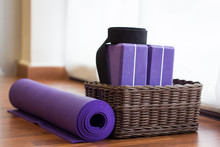 Purple Yoga Mat Rolled By Wick...