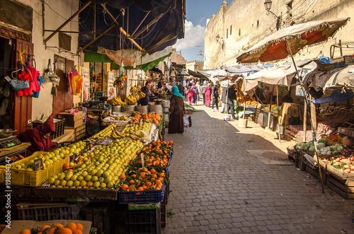 FEZ, MOROCCO - Februari 25, 2018: Fruit marking in the old Medina of Fez city du Canvas Print