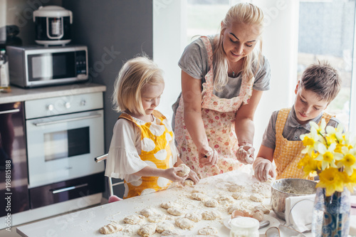 Canvas Prints Cooking Mom cooking with kids on the kitchen