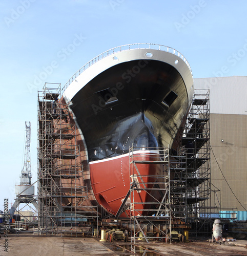 New big ship on dry dock in shipyard. Wallpaper Mural