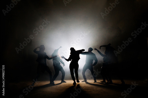 girl performing solo in front of her friends on stage with special effects. own rhythm.
