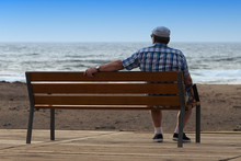Pensioner Sitting On A Bench A...