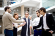 happy business team playing rock paper scissors at modern office