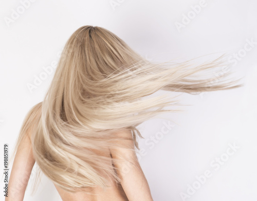 Fotografie, Tablou  Healthy long platinum blonde hair in motion.