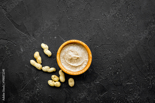 Canvas Prints Bar organic scrub with peanut for homemade spa on black background top view mockup