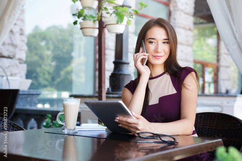 Happy Businesswoman Talking On Phone Outdoors Buy This