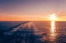 Sunset At Sea With Waterway Of A Cruise Ship