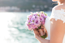 Bride Holds Wedding Bouquet Fr...
