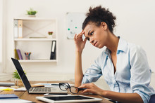 Frustrated Business Woman With Headache At Office