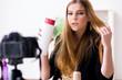 Beauty blogger filing video for her blog or vlog