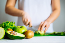 Green Fruits On Front. Woman Cut Fruits On Background. Healthy F