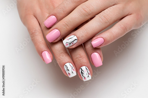Printed kitchen splashbacks Manicure delicate pink manicure with spring flowers on short square nails on a white background