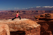 Woman meditating doing yoga in Canyonlands National park in Utah, USA