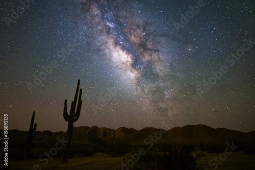 Photo Stands Night The Milky Way and starry night night in the Arizona desert.