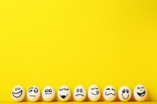 Eggs With Funny Faces On Yello...