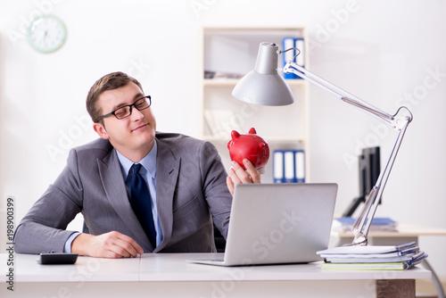 Fototapeta Young employee with piggybank in pension savings concept obraz