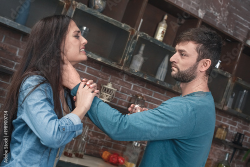 Fototapeta Young family violence social problems concept strangling