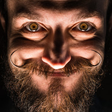 Inventor Hipster With Beard And Mustages In The Dark Room. Smiling Trickster.