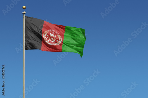 Flag of Afghanistan on a clear blue sky Wallpaper Mural