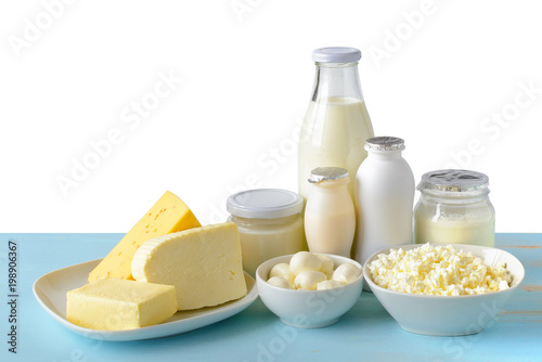 Poster Zuivelproducten Dairy products on blue wooden table isolated on white.