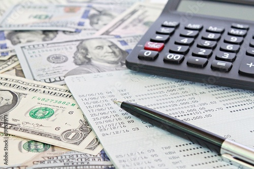 Business Finance Investment Accounting Or Money Exchange Concept American Dollars Cash Calculator And Savings Account Pbook Financial