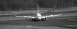 passenger airplane on the ground black and white