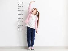 Little Girl Measuring Height N...