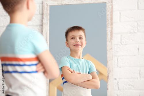 Obraz Cute little boy posing in front of mirror indoors - fototapety do salonu