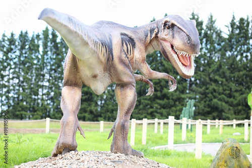 Park of dinosaurs. A dinosaur on the background of nature. Toy d