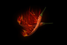 Red Hot Chili Pepper On Black Background With Flame