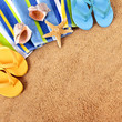 Beach background with towel, starfish and flip flops square format