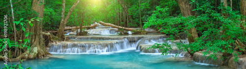 fototapeta na lodówkę Panoramic beautiful deep forest waterfall in Thailand