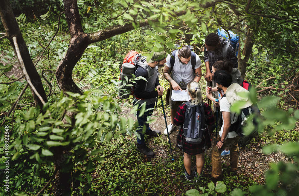 Fototapety, obrazy: Trekking together in a forest