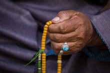Old Tibetan Woman Holding Budd...