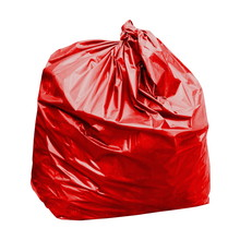 Red Garbage Bag With Concept The Color Of Red Garbage Bags Is Toxic Hazardous (isolated On White Background)