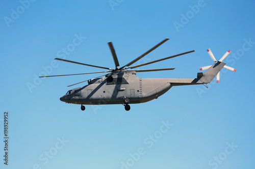 Transport helicopter in flight. Poster