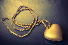 Close Up Of Gold Heart Pendant...